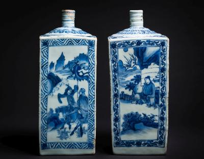 A matched pair of Chinese blue and white square-section bottles with ribbed cylindrical necks, the sides painted with panels depicting scenes from 'The Romance of the Western Chamber', Wanli, 29cm high [one with crack and repair to neck, minor fritting].