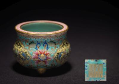 A Chinese famille rose miniature tripod censer in Beijing enamel style, finely painted with blooms and scrolling foliage within yellow ground panels on a turquoise ground, the rim with pink key pattern band between gilt borders, the interior turquoise, gilt six-character Qianlong seal mark, 6cm wide; with fitted case.