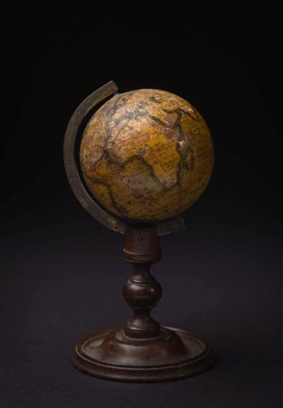 A 19th century 3 inch Cox's Terrestrial globe on stand, inscribed to cartouche 'Cox's terrestrial Globe all discoveries to Feb 1839', metal pinions set in gilt calibrated half meridian on a turned column and circular domed foot, 15.5cm high.