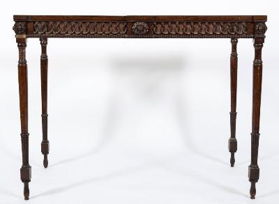 A late 18th Century Italian carved walnut pier table, now surmounted by a rectangular panel of white variegated marble with inset carved white marble circular plaque depicting a classical nude draped female figure beneath a tree, the base with pierced, entrelac and beaded frieze with projecting carved flowerheads, on turned and tapered legs decorated with feathered blocks, the top 115.5cm (3ft 9 1/2in) x 61cm (2ft).