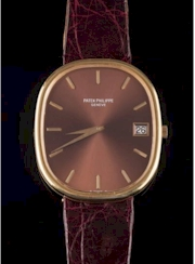 Sale FS30; Lot: 0111: Patek Philippe. A gentleman's 18ct gold 'Ellipse' automatic wristwatch with sunburst brown cushion-shaped dial 34mm long x 29 mm wide with baton markers and date aperture, the movement stamped 1305427 28-255c Adjusted to (5)Five pos heat cold isochronism 36 Thirty six jewels, the rotating weight stamped 'Patek Philippe Geneva', in a case with Swiss control marks and stamped 'Patek Philippe Geneva 3605 2774455, on a dark reddish brown strap with buckle stamped '750 Patek Philippe PP Co'. in fitted case, together with 'Extract from the Archives' of 'Patek Philippe' confirming the original date of sale to be October 4th 1978.