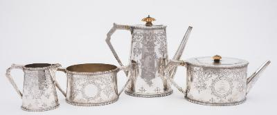A Victorian silver four-piece tea and coffee service, maker Samuel Smily (Goldsmiths Alliance), London, 1870/71 crested and monogrammed, of oval outline with ivory finials to the hinged lids and ivory insulators to the handles, with all over trailing foliate, scroll and hanging basket designs and a beaded rim, total weight of silver 70.83ozs.