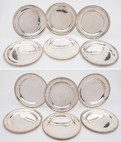 A set of twelve George III silver dishes, maker William Stroud, London, 1802, crested, of plain circular form with gadrooned borders, 25.5cm diameter, total weight of silver 200.90ozs.
