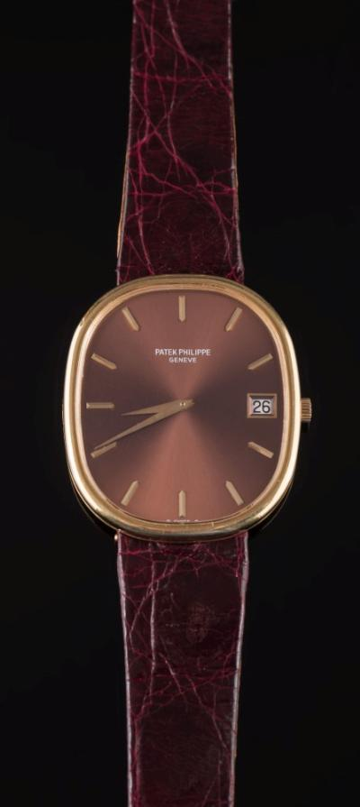 Patek Philippe. A gentleman's 18ct gold 'Ellipse' automatic wristwatch with sunburst brown cushion-shaped dial 34mm long x 29 mm wide with baton markers and date aperture, the movement stamped 1305427 28-255c Adjusted to (5)Five pos heat cold isochronism 36 Thirty six jewels, the rotating weight stamped 'Patek Philippe Geneva', in a case with Swiss control marks and stamped 'Patek Philippe Geneva 3605 2774455, on a dark reddish brown strap with buckle stamped '750 Patek Philippe PP Co'. in fitted case, together with 'Extract from the Archives' of 'Patek Philippe' confirming the original date of sale to be October 4th 1978.