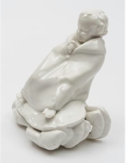 Sale FS31; Lot: 0630: A Royal Doulton figure Child on a Crab HN.32, possibly a prototype, modelled in the white, green backstamp.