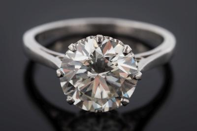 A platinum and diamond single-stone ring the circular brilliant-cut stone approximately 9.35mm diameter x 5.65mm depth, estimated to weigh 3.1cts in a scroll-pierced eight-claw setting, ring size 'N 1/2'.