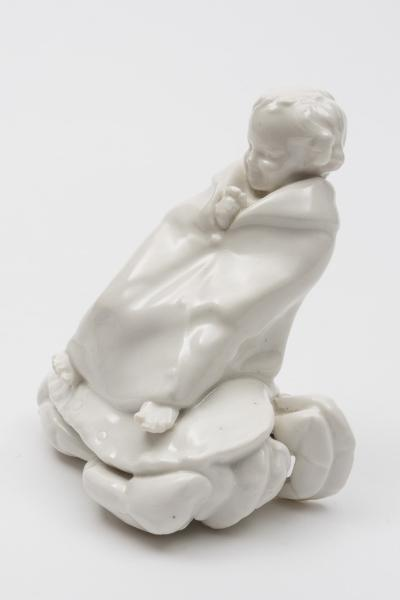 A Royal Doulton figure Child on a Crab HN.32, possibly a prototype, modelled in the white, green backstamp.