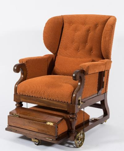 A 19th Century mahogany and upholstered patent adjustable wing armchair, in brown moquette fabric, having an adjustable buttoned back, hinged padded arm supports and extending foot rest, the whole on brass wheel castors.