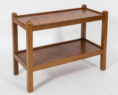 By Robert Thompson of Kilburn 'The Mouseman' - An oak rectangular two tier trolley, with square section uprights, the top 86.5cm (2ft 10in) x 39.5cm (1ft 3 1/2in).