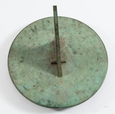 John Bird, London, a fine 18th century bronze sundial the 41.5cm circular engraved scale with outer ring of Roman numerals, before/after the sun ring, calendar ring and compass points, with bronze gnomon, signed John Bird, London, bears Coat of Arms for the Buller family, green verdigris patination overall.