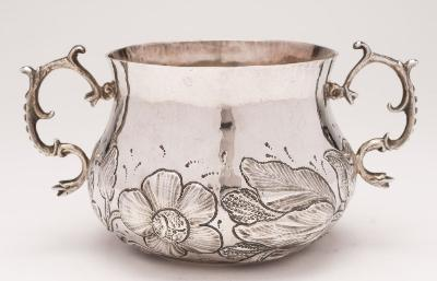 Sale FS34; Lot: 0189: A Charles II silver porringer, maker HG between mullets and pellets attributed to Henry Greenway (See Jacksons page 121), London, 1664 pricked dot initials to the base, of squat baluster form with embossed floral decoration and scroll handles to the sides, 17cm wide, 8.05ozs.