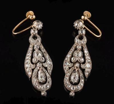 Sale FS34; Lot: 0235: A pair of diamond pendant earrings each with a circular, old-cut diamond suspending a tapering drop and pear shaped drop with a single, pear shaped diamond in cut down collet setting, total diamond weight approximately 5.0cts, with screw back fittings, 50mm total length of earrings, 13.5gms gross weight.