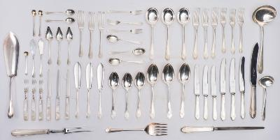 A silver Art Deco design flatware service maker James Dixon and Sons, Sheffield, 1945/1947 initialled. Comprising - twelve table forks, twelve dessert forks, twelve soup spoons, twelve dessert spoons, twelve fish knives, twelve fish forks, pair of fish servers, twelve teaspoons, twelve cake forks, twelve grapefruit spoons, twelve coffee spoons, two butter knives, two preserve spoons, one salt spoon, one mustard spoon, one soup ladle, two sauce ladles, six tablespoons, four-piece carving set, twelve silver handled knives, twelve silver handled dessert knives, twelve silver and mother-of-pearl handled dessert knives, twelve matching forks in two sizes. weighable silver 207.23ozs.