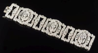A 1930s diamond mounted bracelet with three large rectangular openwork links and three smaller links pave and channel-set with brilliant and baguette-cut diamonds (two settings vacant) estimated to weigh a total of 35cts including three principal circular diamonds each approximately 1.25cts, 104gms gross weight and in fitted case.