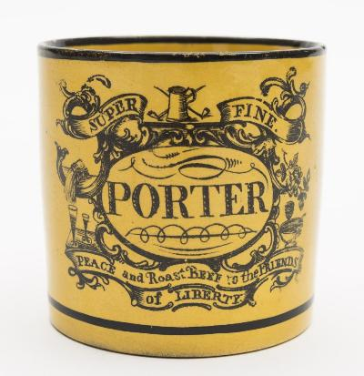 A Staffordshire canary yellow-ground pottery 'Porter' mug of cylindrical form with leaf-capped scroll handle, transfer printed in black with an elaborate cartouche incorporating the inscription 'Porter/Super Fine/Peace and Roast Beef to the Friends of Liberty', circa 1805-10, 8cm high [minor hair crack to base].