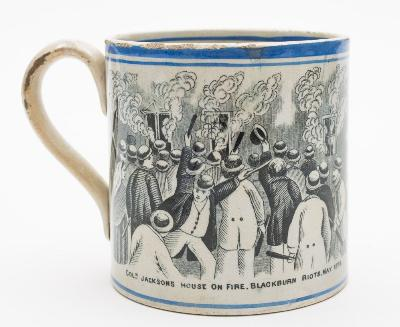 A 19th century transfer printed pottery mug commemorating the 'Blackburn Riots' decorated in black with two prints titled 'Blackburn Riots May 1878' and 'Col Jackson's House on Fire, Blackburn Riots May 1878' between blue line borders, 10.5cm high [minor glaze losses]. * the riots of 1878 took place in Blackburn and Darwen and were the product of a breakdown of the process of negotiation between the cotton masters and their workforce. The Lancashire cotton industry suffered from a 'boom and bust' economy and following a slump in the 1870s, the Cotton Masters Association, chaired by Col Robert Jackson, had imposed a region-wide pay cut.