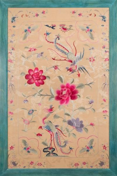 A large late 18th/early 19th century Chinese embroidered panel depicting fish, exotic birds and butterflies, amongst flowering shrubs, worked in pastel silks of blues, pinks, reds and greens to an ivory field, 99 x 63cm framed and glazed.