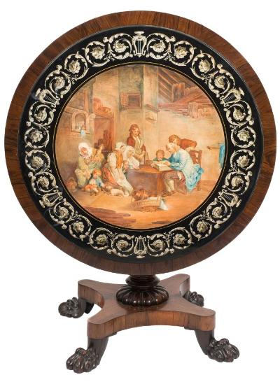 A 19th Century Italian scagliola circular table top, painted with an interior scene in watercolour depicting figures gathered around a table, on an early Victorian carved rosewood base with foliate decorated central column quatrefoil platform and quadruple claw feet, 93cm (3ft 0 1/2in) diameter.