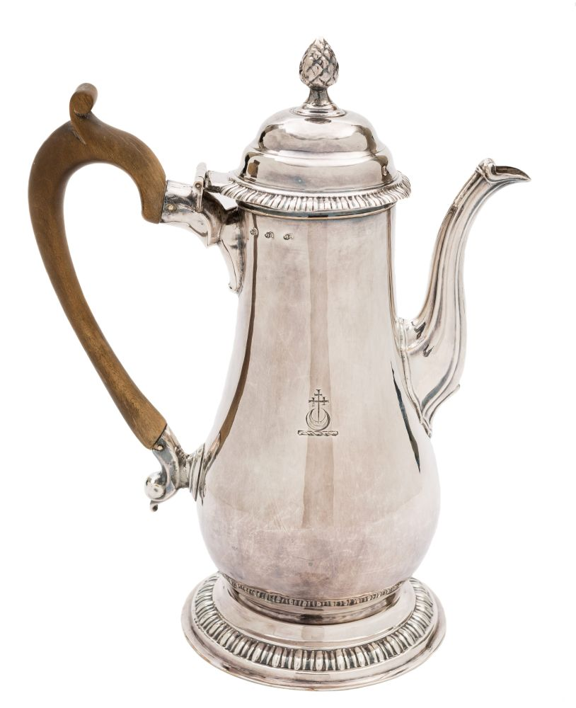 Sale FS36; Lot: 0002: A George III old Sheffield plated coffee pot, struck three times for Henry Tudor & Co, circa 1760-65 crested, of baluster form, the domed hinged lid with pineapple finial, reeded spout, raised on a circular foot, 25.5cm high.