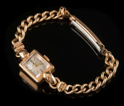 Rolex. A lady's 18ct gold cased wristwatch the rectangular dial 11mm x 10mm in case with presentation initials dated '1954' on a gilt metal bracelet.
