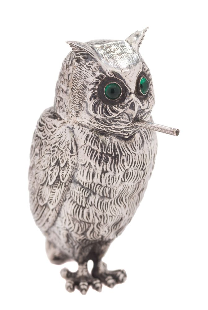Sale FS37; Lot: 0267: A Continental silver cigarette holder in the form of an owl smoking a cigarette, the hinged head with green paste inset eyes stamped 800, having a textured feather body, 13cm high. 4.72ozs.