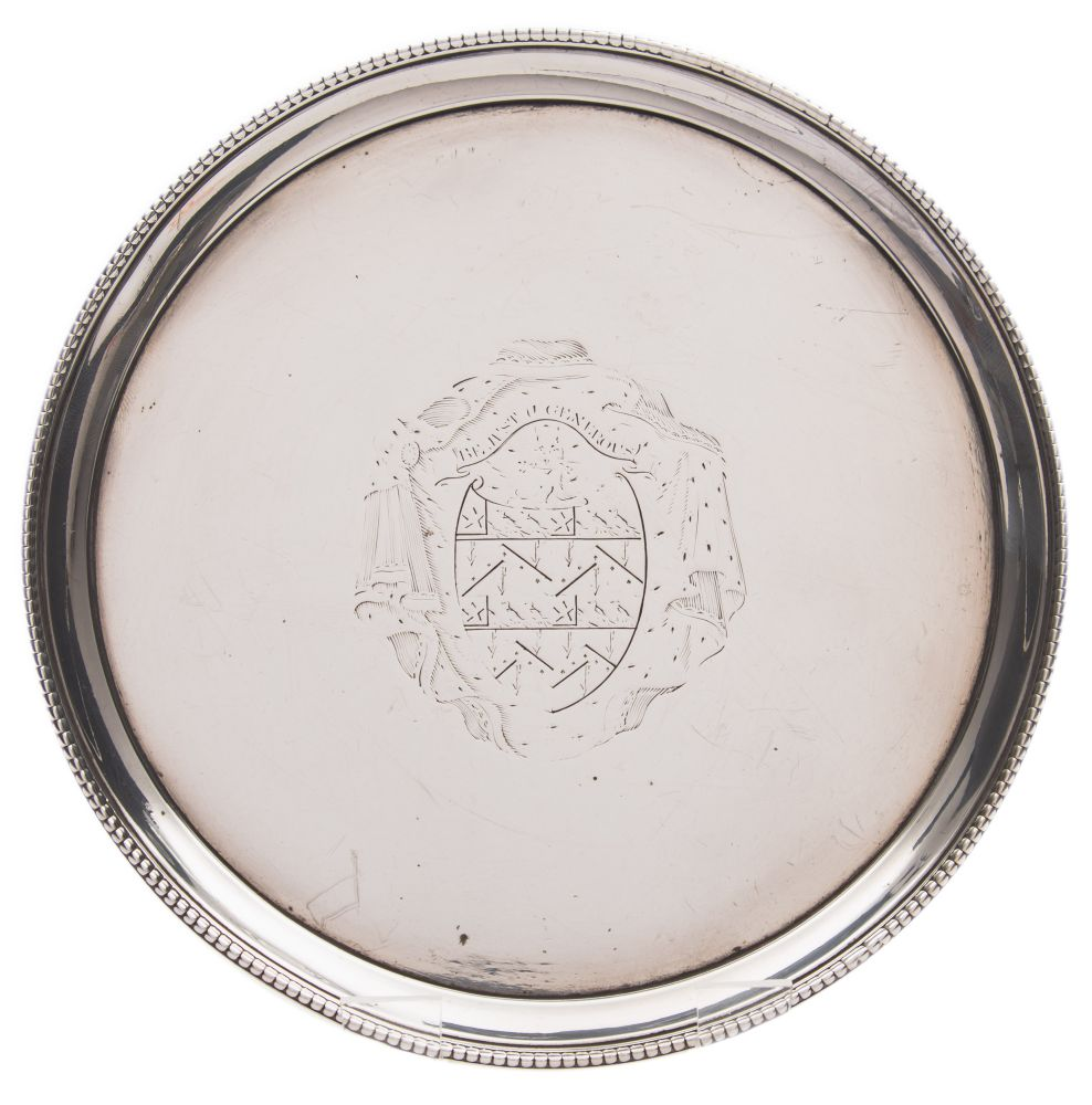 Sale FS37; Lot: 0289: A George III silver salver, maker John Crouch I & Thomas Hannam, London, 1775 crested, of plain circular form with beaded border, raised on three swept feet, 18cm diameter, 10.35ozs.