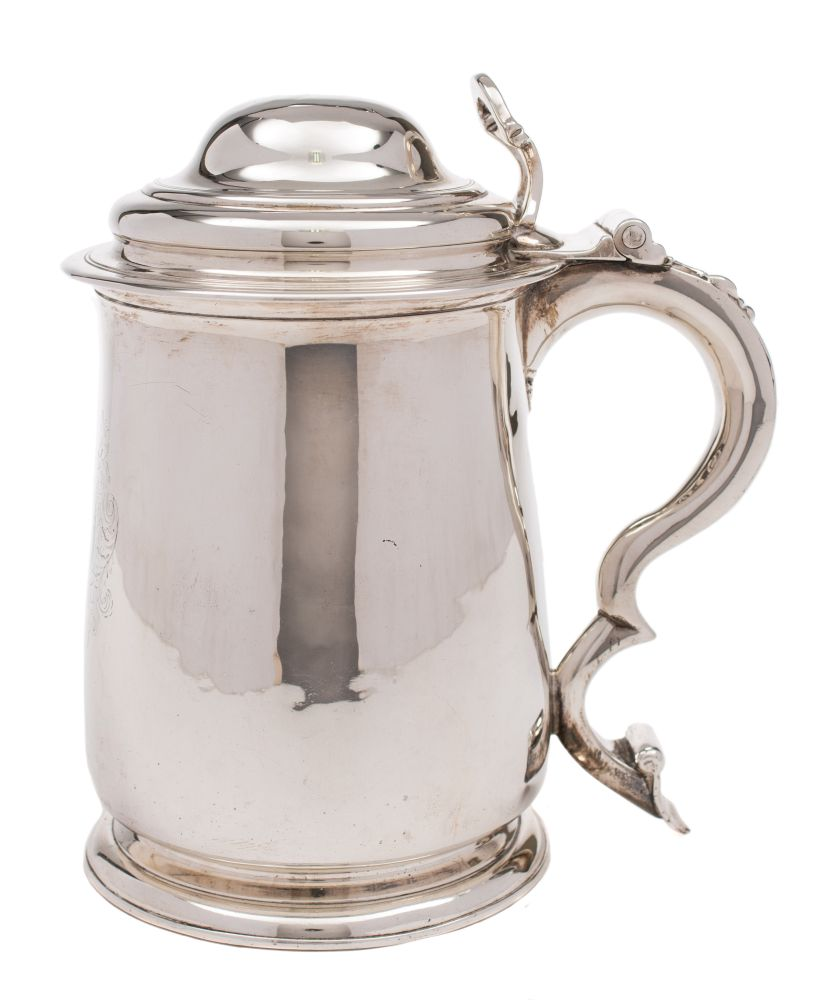 Sale FS37; Lot: 0366: A George II silver tankard, maker Thomas Farren, London, 1733 crested, of cylindrical form, having a stepped domed hinged lid with arched thumbpiece, scroll handle to the side, raised on a spreading circular foot, 20cm high, 29.55ozs.