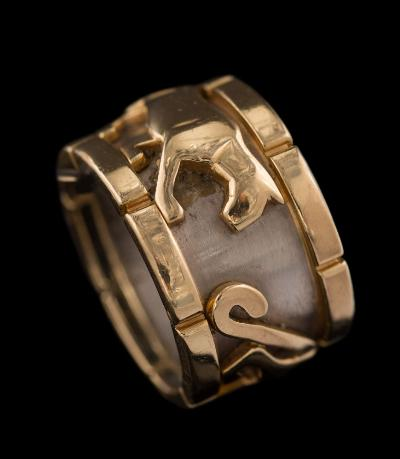 Sale FS37; Lot: 0528: Cartier. A two-colour 'Panthere' ring signed 'Cartier', numbered '642684' and '54', 14gms gross weight, ring size N.