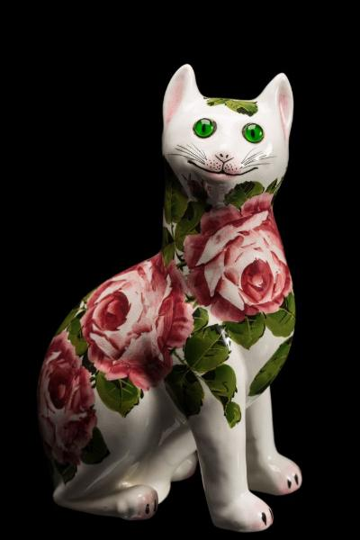 Sale FS37; Lot: 0746: A Wemyss Ware pottery cat modelled in seated posture and decorated with pink cabbage roses, with inset glass eyes, painted Wemyss Ware JN and Made in England, 32.5cm high.