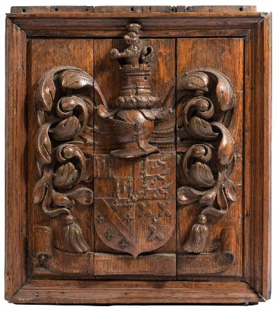 Sale FS37; Lot: 1015: A carved oak coat of arms plaque the quartered shield surmounted by a knight's helmet, turret and castle flanked by foliage and tassels, 75 x 69cm .