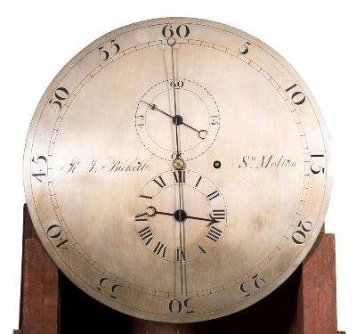 Sale FS37; Lot: 1072: R J Bickell, South Molton, a floor-standing regulator the eight-day duration, timepiece movement having a dead-beat escapement with screw-adjustment for the depthing of the wheel arbors, with a brass-bound weight and brass bob to the wood-rod pendulum, the round silvered fifteen-inch dial engraved with a typical regulator layout showing seconds to the outer aspect and with hour and minute subsidiary dials to the centre and engraved with the name RJ Bickell, So. Molton, with blued steel spade hands, the curved topped mahogany case having a glazed trunk door, canted corners, inset shaped panels to the hood either side of the dial and an inset panel to the base, height 202cm * Biography Richard John Bickell is recorded as a clock and watchmaker, silversmith and gunsmith at South Street, South Molton in 1838 and then Broad Street from 1844 until 1878. He was mayor of the town in 1852 and made and supplied the Town Hall clock in 1851/52 for which he was paid £101.00. The address for the business was given as 19, Broad Street in 1883, whilst his home address is recorded as Sunnyside.