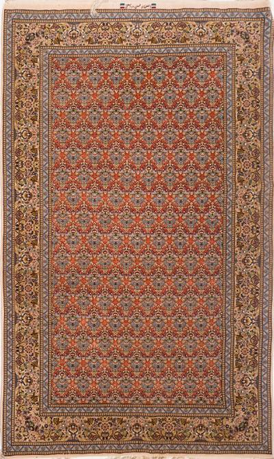 Sale FS37; Lot: 1082: An Isfahan rug, the brick red field with a repeated design of urns of flowers, enclosed by main pistachio border with birds, flowering foliage and urns, 245cm x 153cm.