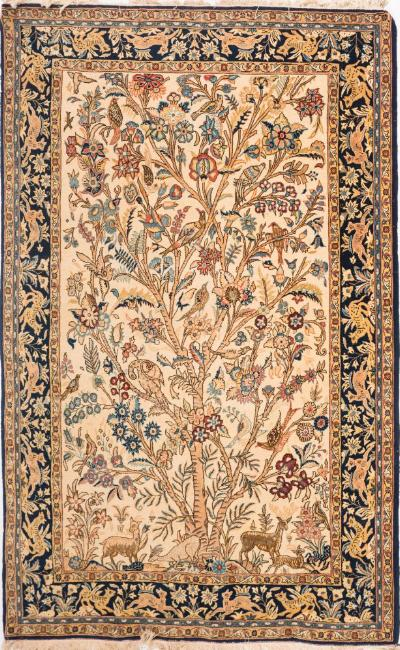 Sale FS37; Lot: 1088: An Qum Tree of Life rug, the beige field with a design of numerous birds on a flowering tree and with animals at the base, enclosed by a main indigo border with a design of animals and flowering plants, 216cm x 143cm.