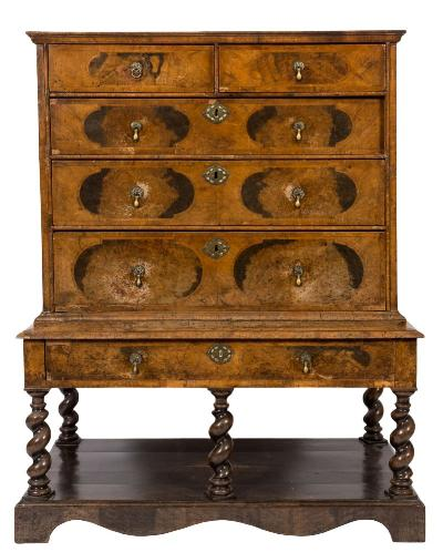 Sale FS37; Lot: 1128: A late 17th Century walnut and cross and feather banded chest on later stand, the upper part with a quarter veneered top, moulded cornice and containing two short and three long drawers with geometrically inlaid panels, the later stand fitted with a single long drawer on spirally turned legs, united by a platform base, with shaped apron and bracket feet, 107cm (3ft 6in) wide, 134cm (4ft 4 3/4in) high.