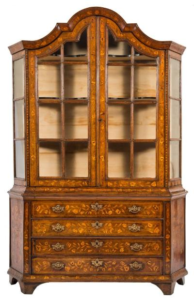 Sale FS37; Lot: 1204: A late 18th/early 19th Century Dutch walnut and floral marquetry domed display cabinet, of canted outline, decorated with trailing flowering stems bordered with sycamore lines, the domed upper part with a moulded cornice, having fixed serpentine fronted shelves enclosed by a pair of moulded glazed panel doors, between chequer inlaid stiles, the lower part containing three long drawers flanked by canted angles with panels each decorated with a bird amongst urns of flowers and foliage, on bracket feet, 145cm (4ft 9in) wide, 216cm (7ft 1in) high.