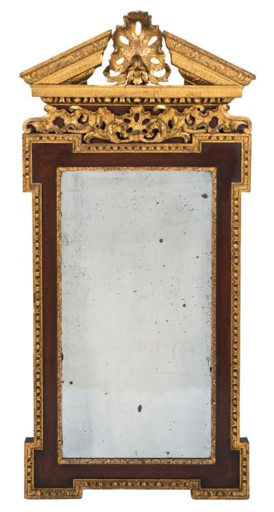 Sale FS37; Lot: 1209: A 19th Century walnut and parcel-gilt architectural wall mirror, in the George II taste, the acanthus decorated broken pediment centred by a palmette spray, having a similar palmette and acanthus scroll frieze, the rectangular bevelled plate within a gilt foliate slip and shaped egg and dart surround, 129.5cm (4ft 3in) x 60cm (1ft 11 1/2in).