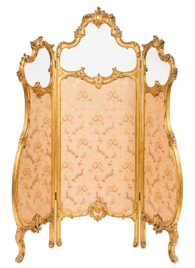 Sale FS37; Lot: 1231: A French carved giltwood cartouche-shaped three fold screen, with glazed panels above in moulded acanthus scroll and flowerhead surrounds and with upholstered floral foliate panels below, on scroll feet, 169.5cm (5ft 6 3/4in) x 147cm (4ft 10in) overall.