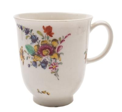 A Bow chocolate cup with loop handle, painted with a floral spray and scattered sprigs, circa 1760-65, 8cm high.