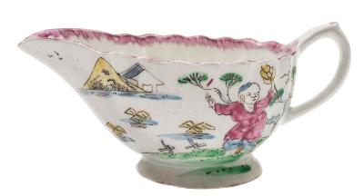A Bow creamboat of fluted form, painted in Mandarin style with dancing figures in lake landscapes, pink feather edged rim, circa 1760, 12.5cm long.