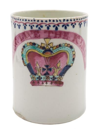 A Lowestoft 'Royal Commemorative' mug with scroll handle, painted in puce, blue, turquoise and yellow with a crown and banner inscribed 'Long Live the King' below a dot, loop and arrow border, circa 1790-95, 8.5cm high.
