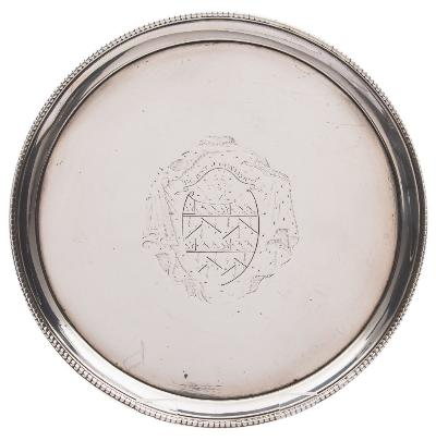 A George III silver salver, maker John Crouch I & Thomas Hannam, London, 1775 crested, of plain circular form with beaded border, raised on three swept feet, 18cm diameter, 10.35ozs.