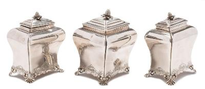A set of three George II tea caddies, maker Pierre Gillois, London 1754/55/56 of bombe outline, each with shallow domed lift-off lid and strawberry finial, the waisted bodies with chased scroll decoration raised on curved shell feet,(the larger caddy missing one foot), contained in a Victorian rosewood fitted box, 29cm wide, total weight of silver 23.38ozs.