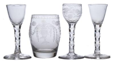 Sale FS37; Lot: 0662: Two late 18th century English wine glasses, one similar and an early 19th century barrel-shaped tumbler the first two with plain bowls and faceted stems, 13.5 cm; the third engraved with floral sprays and on faceted stem, 14 cm; the tumbler engraved with urns, paterae and swags with the initials 'GS', 11 cm.