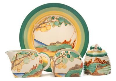 Sale FS37; Lot: 0760: Four pieces of Clarice Cliff Bizarre Secrets pattern pottery comprising a small plate, a beehive preserve pot and cover and a Bonjour shape cream jug and sugar bowl, with painted landscape decoration within green and yellow bands, Bizarre backstamps, plate with additional Fantasque marks, circa 1933-37, [bee knop restored, knife marks to plate].