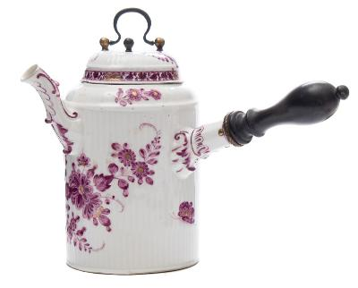 A Meissen chocolate pot and cover with turned wood handle, scroll spout and ribbed relief moulding, painted in purple camaieu and gilt with rockwork, flowers and foliage, faint underglaze blue crossed swords mark, circa 1760-70, 16cm high.