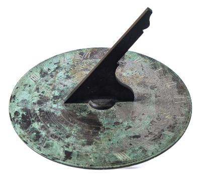 Sale FS37; Lot: 0861: J Barker & Son, London. a bronze 12ins sundial with shaped gnomon, with incised compass, scales for months and days, watch slower, watch faster and Roman numerals, signed J Barker & Son, London.