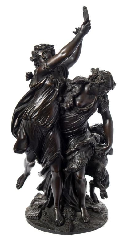 After Clodion (1738-1814) a large study of bacchanalian nymphs and young satyr the dancing nymphs holding grapes and a tambourine, signed to the naturalistic base, Clodion 1762, rich dark brown patination, 75cm high.