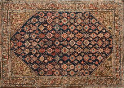 Sale FS37; Lot: 1081: A Feraghan rug, the indigo field with a Mina Khani geometric lozenge and medallion design, enclosed by saffron spandrels with boteh designs and main beige hooked foliate stem border, 191cm x 138cm.