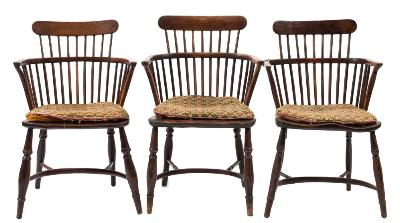 Sale FS37; Lot: 1108: A harlequin set of five early 19th Century yew-wood, elm and beech comb back Windsor elbow chairs, having shaped solid seats on turned and tapered splayed legs, united by crinoline stretchers.