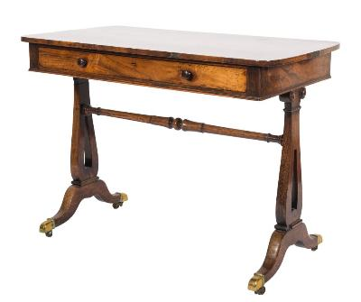 Sale FS37; Lot: 1167: A Regency rosewood rectangular side table, the top with slightly curved ends, fitted with a single long frieze drawer, on open lyre -shaped standard end and dual splayed legs, united by a turned stretcher, terminating in brass cappings and castors, 99cm (3ft 3in) long x 53cm (1ft 9in) deep.